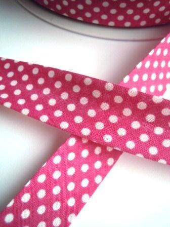 Schrägband, gepunktet, weiß auf pink