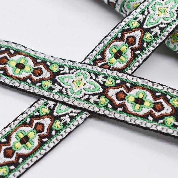 Ornamente grün-braun auf schwarz, Webband