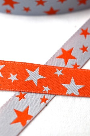 unregelmäßige Sterne, grau-orange, Webband beidseitig