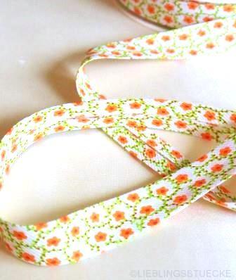 Schrägband, Blumenranke, orange