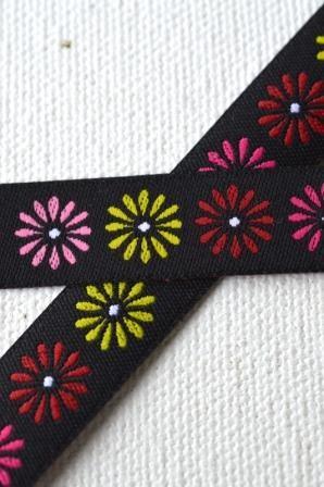 bunte Gänseblümchen, schwarz, Webband