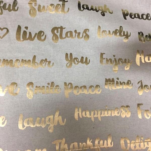 Dekostoff Metallic Schrift gold auf leinen