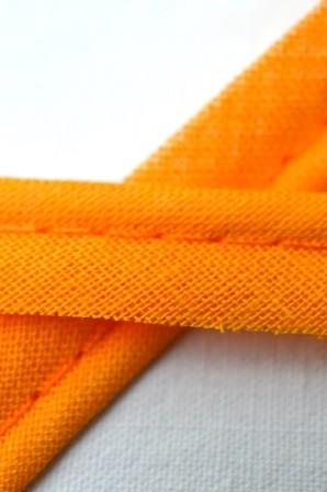 Baumwollpaspel, orange