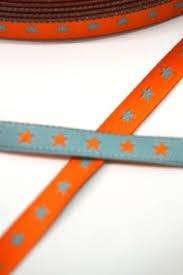 schmales Sternchenband, orange-türkis, Webband beidseitig