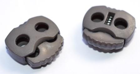 Kordelstopper, 2 löchrig, graubraun