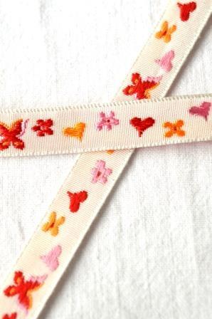 Schmetterling und Herz, Webband