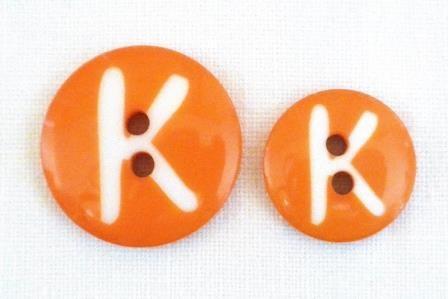 Buchstabe K, Knopf