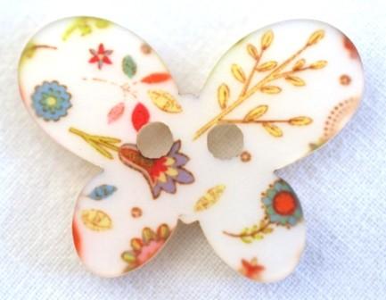 Blumen auf Schmetterling, Knopf