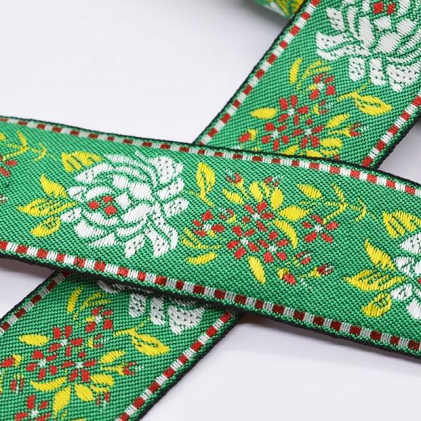 Tracht Blumen auf grün, Webband