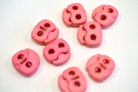 Kordelstopper, 2 löchrig, rosa
